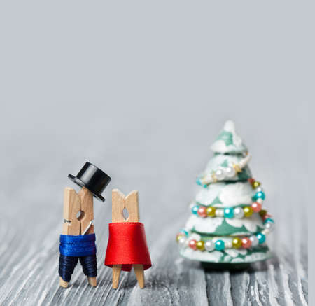 fur tree: Abstract clothespins heroes Old fashioned man and woman and christmas fur tree with decorative balls. Stock Photo