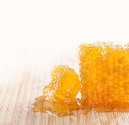 tasty honeycomb on the wooden table. Imagens