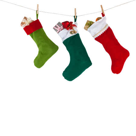 green: colorful xmas socks. red, green, dark green color. rope with clothespins. design decoration element, isolated