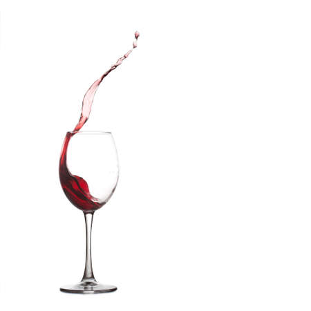 Pouring red dessert wine into glass,  wine glass splash, close-up, white background. copy space Stock Photo - 48244708