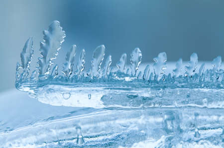 glass thermometer: Frozen ice, icicles close-up. Winter weather concept. soft focus