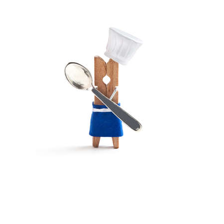 culinary skills: Chef cooking with spoon on white background. Funny clothespin restaurant character dressed in white hat, blue apron. Kids menu concept. isolated