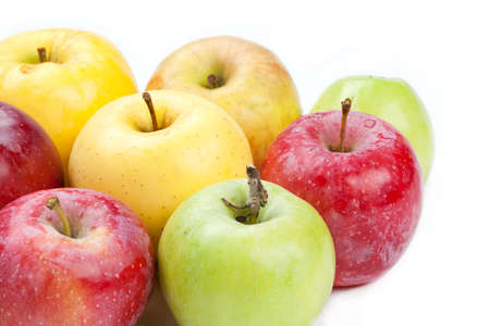 innate: Multi colored apples  different varieties. White background. close-up