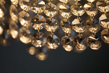 cutglass: Retro style crystal chandelier. transparent pendant macro view. light background soft focus. shallow depth of field Stock Photo