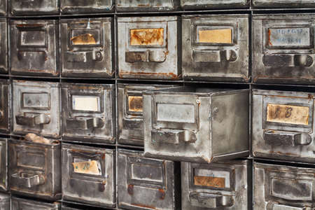 file box: Opened archive file box, filing system. Rare metal boxes textured used shabby silver surface. library service, file cabinet interior concept.