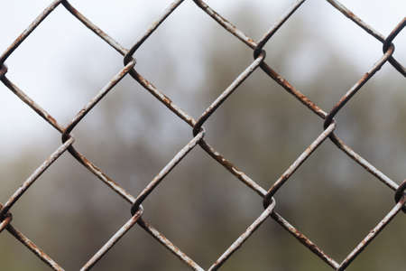 mesh fence: Aged mesh fence. aged metal texture, macro view Stock Photo