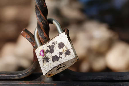 padlocked: Vintage lock macro view. Security concept with closed silver padlock. soft focus Stock Photo
