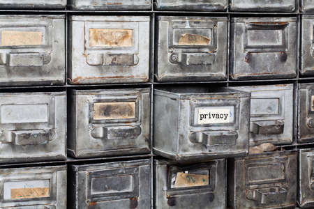 filing system: Privacy information concept. filing system with opened metallic box. Aged paper textured nameplates. Retro style storage, information protect security