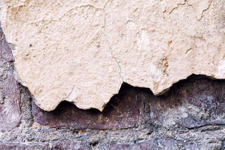 unevenly: Damaged wall macro view. Textured vintage suface. Shallow depth of field, soft focus image Stock Photo