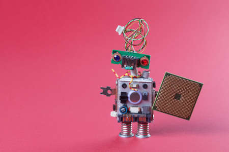 head toy: Robot with electronic chip board. vintage design toy mechanism with funny head, electrical wire hairstyle, colorful blue red eyes. Copy space, pink background