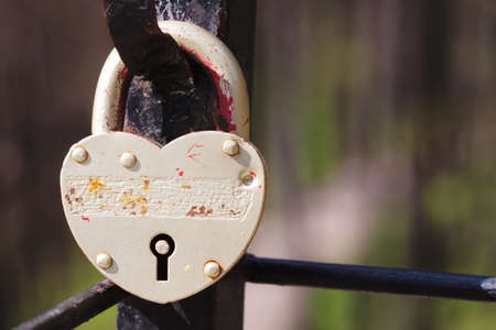 Vintage lock macro view. Security concept with closed silver padlock. soft focus, shallow depth of field Stock Photo