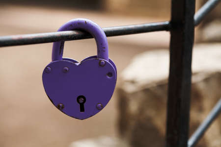 Aged padlock. Love heart shape design, red paint metal texture, pattern and vintage design. love sign and romance symbol concept. Valentines day greeting card template