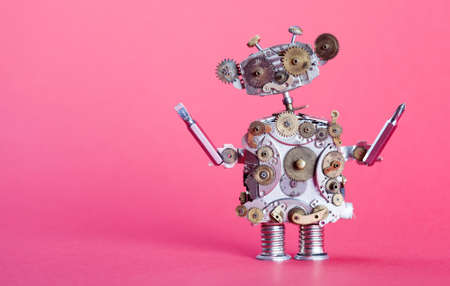 Steampunk service robot concept. Repair man with screw drivers. Aged gears, cog wheel hand clock parts mechanism. Shabby scratch metal texture. Pink background, shallow depth of field