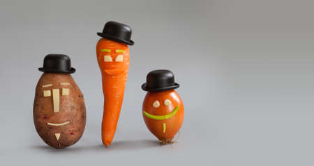mister: Smiling vegetable characters. Mister potato, miss carrot gentleman onion with funny faces black hat. Vegan family kids menu concept. Gray background, copy space