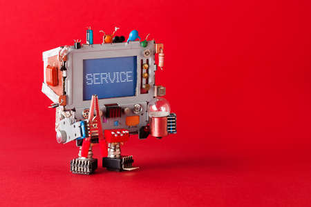 Service center and repairing concept. Tv robot handyman with pliers and light bulb in hands. Warning message service on blue screen monitor head. macro view, red background copy space.
