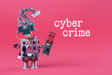 cybercrime: Cybercrime and data hacking concept. Retro robot with usb flash storage stick, stylish computer character blue eyed head, electrical wire hairstyle. Pink background photo Stock Photo