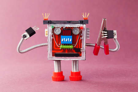 serviceman: Handyman ready for work. Serviceman robot character with red pliers. Violet background photo
