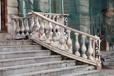mediteranean: Aged white stone stairway. hierarchy stepping stones concept. Damaged object photo Stock Photo