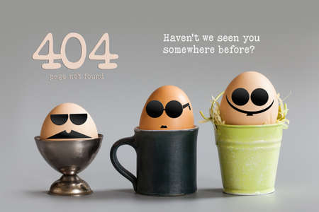 Error 404 page not found concept. Funny egg characters with black eye glasses sitting in cup bucket. Gray paper background text quote Havent we seen you somewhere before. Stock Photo