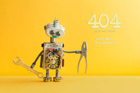 404 error page not found concept. Don't panic I'm a mechanic. Hand wrench pliers robot handyman on yellow background. Cyborg toy lamp bulb eyes head, electric wires, capacitors vintage resistors