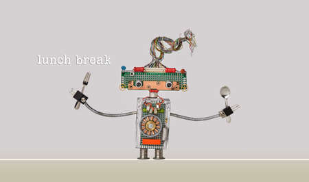 Lunch break poster. Funny robotic toy fork spoon in arms. Gray beige background.
