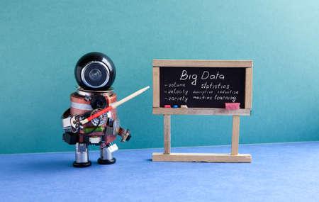 Big data machine learning concept. Futuric robot professor explains modern theory. Teacher with a pointer near chalkboard, main topics handwritten. Blue green interior classroom