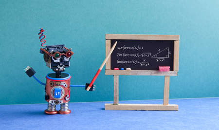 Math lesson in college. Robot teacher explains theory inverse trigonometric functions. Classroom interior with handwritten formula black chalkboard. Blue green colorful background