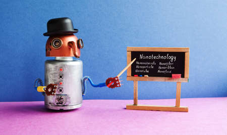 Robot professor explains Nanotechnology. Funny black hat cyborg character, classroom interior with black chalkboard handwritten topics about nanomaterials. Blue pink colorful background