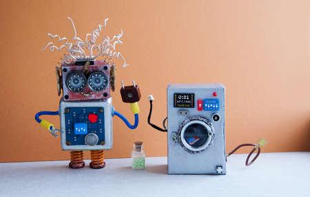 Washing machine laundry concept. Crazy robot handyman, brown light blue interior, blue floor. Funny toys creative design. Stock Photo