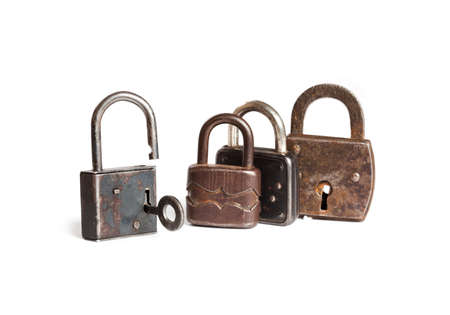 Retro style padlocks. metal textures and pattern. one opened, three closed. White background. Stock Photo