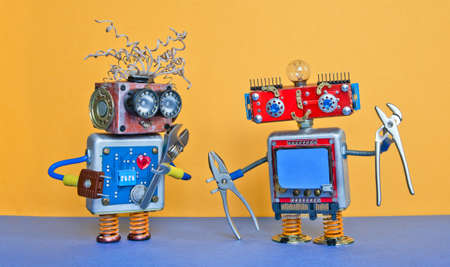 Industry 4.0 service repair maintenance concept. Creative design robotic toys, adjustable spanner silver pliers tools. Funny face robotic characters on yellow blue background
