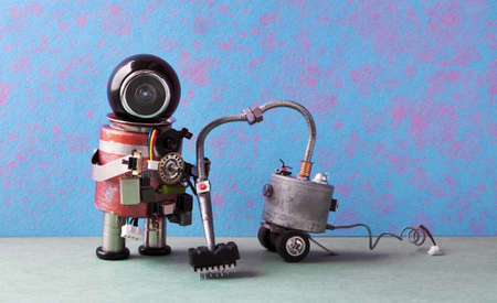 Robot janitor vacuuming. Cleaner machine creative design robotic android cleaning home, blue pink green apartment interior Stock Photo