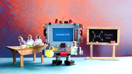 Pharamacy chemistry laboratory research center. Robot with chemical glass. Black chalkboard, wooden table and reagent glass bottles, drugs pills. Blue brown red green interior. Stok Fotoğraf