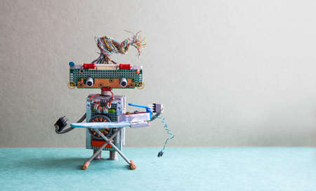 Robot with steam iron on the board. gray wall green floor room interior. Creative design toys housework concept. Copy space