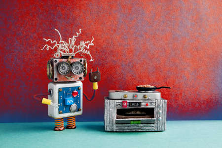 Robotic chef preparing meal frying pan, electronic stove oven. Creative design robot toy, automation smart home concept. Red blue wall, green floor background.