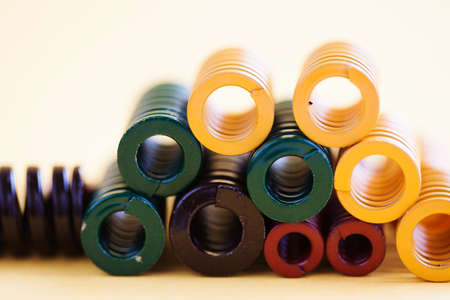 Abstract steel spiral coil springs collection set. Different hardness flexibility size colorful objects. Shallow depth of field photo.