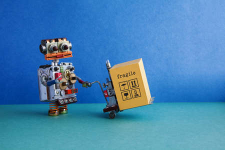 Robot delivery service automation logistic. Friendly robotic toy, powered pallet jack, forklift cart mechanism loaded cardboard container. Box packing symbols. Blue wall, green floor background