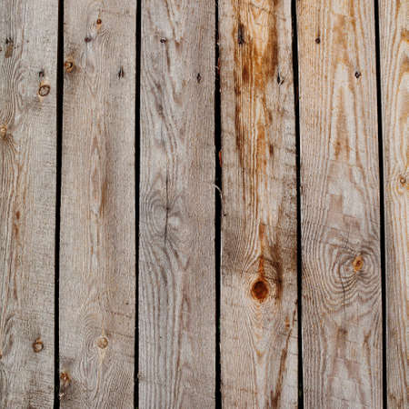 Shabby wooden boardwalk, wooden tiles aged planking texture.