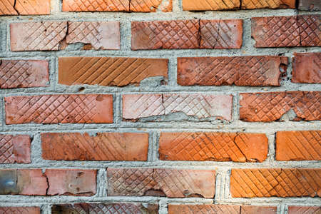 Aged orange red brick wall background. Vintage brickwork abstract object macro view.