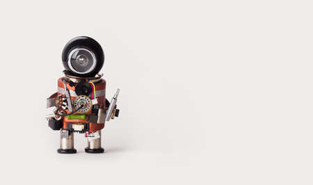 Robot mechanic handyman with screw drivers. White background, copy space.