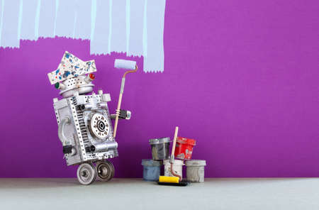 Crazy robot painter at work. Funny decorator with paint roller and buckets, purple colored room redecoration. Copy space.