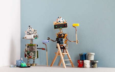 Two robots painters with paint rollers, wooden ladder and paint buckets ready for apartment improvement