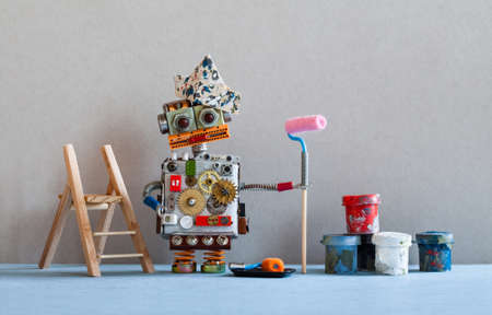 Robot painter decorator with paint roller, wooden ladder. Gray wall blue floor room interior.