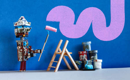 Decorator robot repaints the wall of the room in purple color. Funny painter robot toy and indoors interior redecoration concept