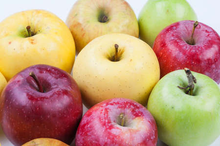 Ripe apples assortment different types. Macro view organic apple fruits red yellow green color. Macro view.