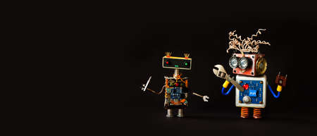 Robotic electronics repair service. Serviceman handyman mechanical toy robots on black background. copy space.