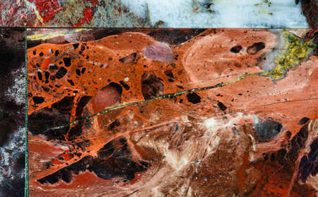 Red Jasper tiles. Decorative stone background macro view. Multi color natural mineral surface with a unique pattern and texture. Banco de Imagens