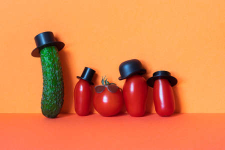 Mister green cucumber and red Tomato family. Funny vegetables with black old fashioned hats. Creative design food poster.