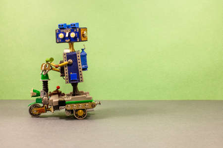 Funny steampunk robotic biker drives an electric scooter. Imagens