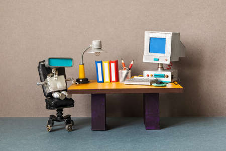 Robot office manager, retro style workplace. Old table with vintage computer, desk lamp and books. Stylish black leather office chair. Machine learning artificial intelligence concept